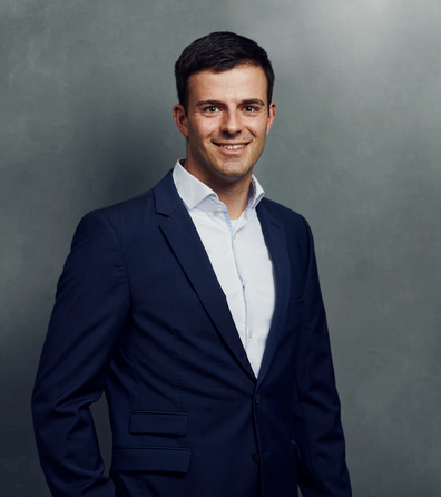 Meet the Team of experts - Photo of Christian Classen, person in business suit, smiling, male, gallantly, standing upright