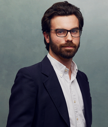 Meet the Team of experts - Photo of Fabrice Van Boeckel, person in business suit, glasses with dark frames, smiling, male, gallantly, standing upright