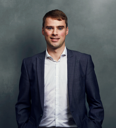 Meet the Team of experts - Photo of Pádraic Burke, person in business suit, smiling, male, gallantly, standing upright