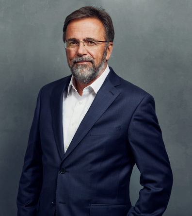 Meet the Team of experts - Photo of Ulrich Classen, person in business suit, glasses, smiling, bearded men, gallantly, standing upright