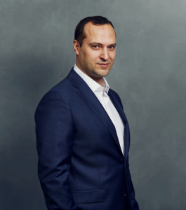 Meet the Team of experts - Photo of Vasil Savov, person in business suit, smiling, male, gallantly, standing upright